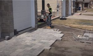 Paving Simcoe County worker adding interlocking bricks