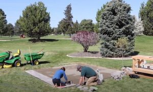 Barrie Interlocking workers paving small patio deck
