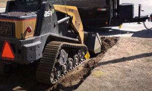 Barrie Paving digger removing the soil for interlocking bricks installation