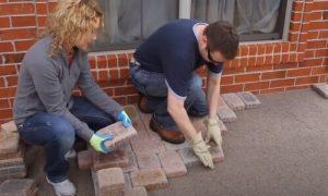 Paving Simcoe County workers laying interlocking bricks