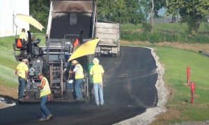 Simcoe Paving asphalt paving workers on a road