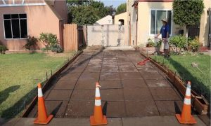 Barrie concrete paving and spraying with water on the ground